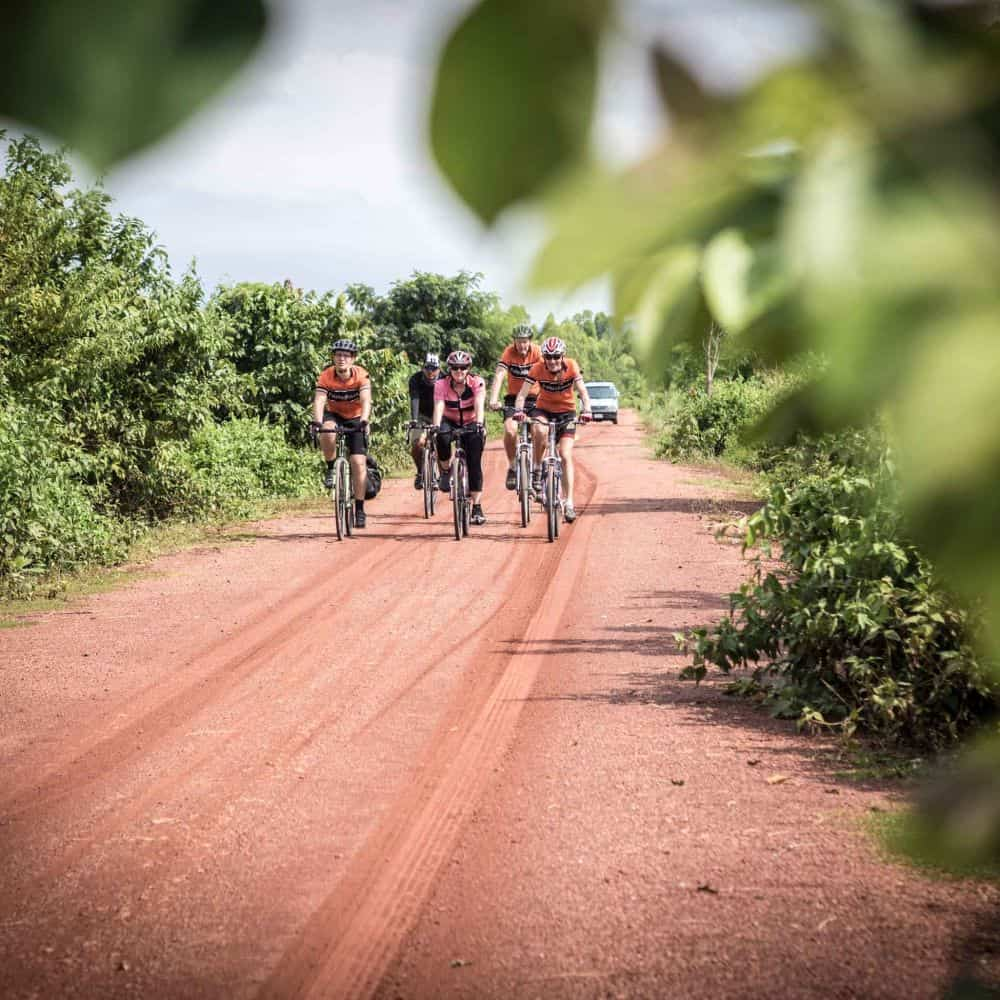 cyclists on red gravel road north Thailand