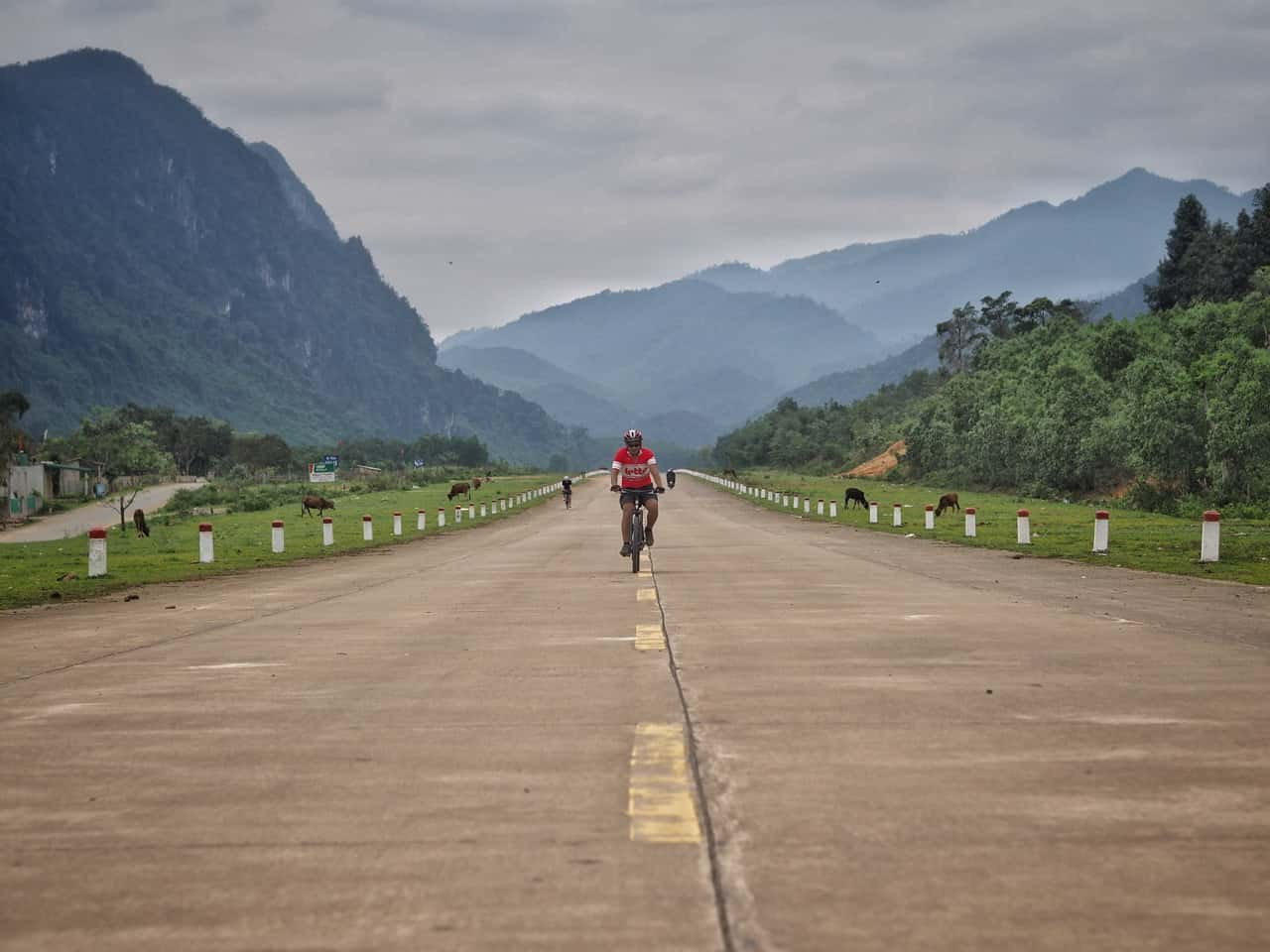 cyclist on old US runway central Vietnam