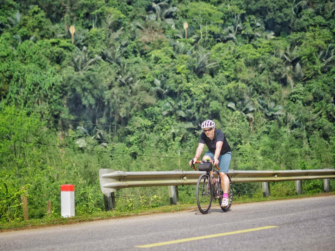 cyclist on jungle road vietnam