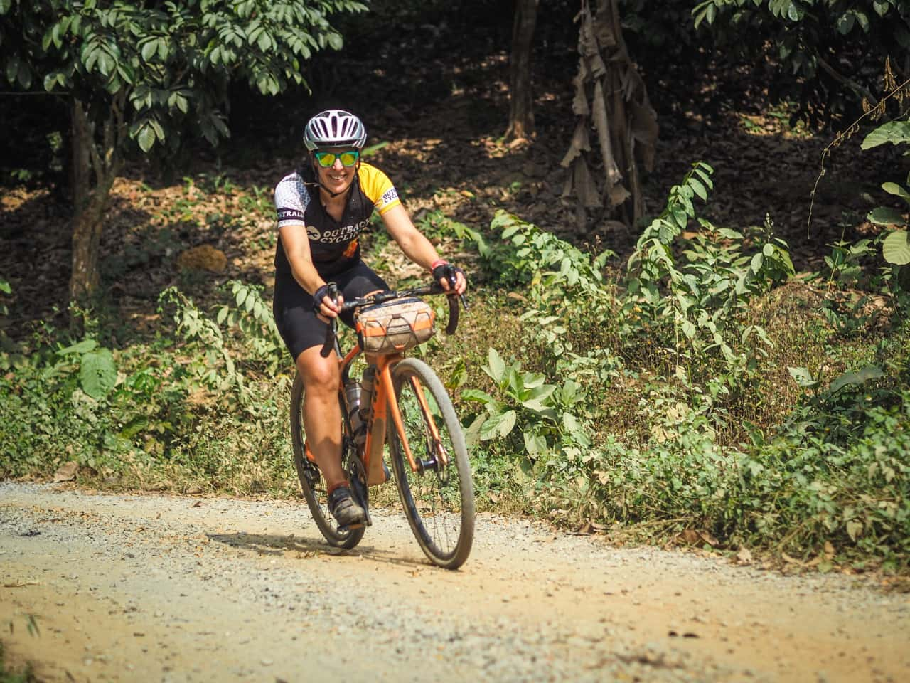 gravel cyclist on cycling organised tour in Thailand