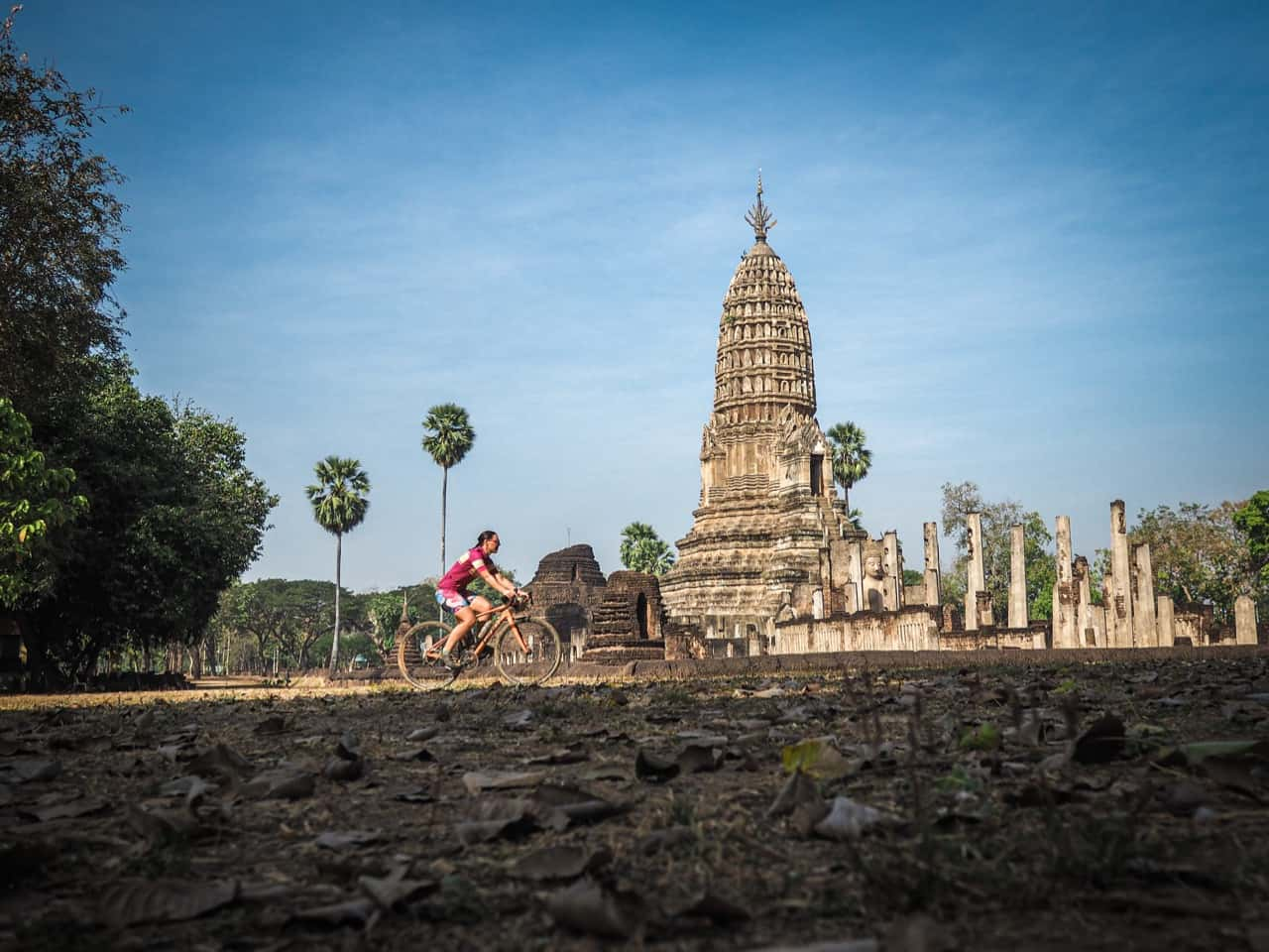 passing an ancient stupa whilst on gravel cycling tour in Thailand