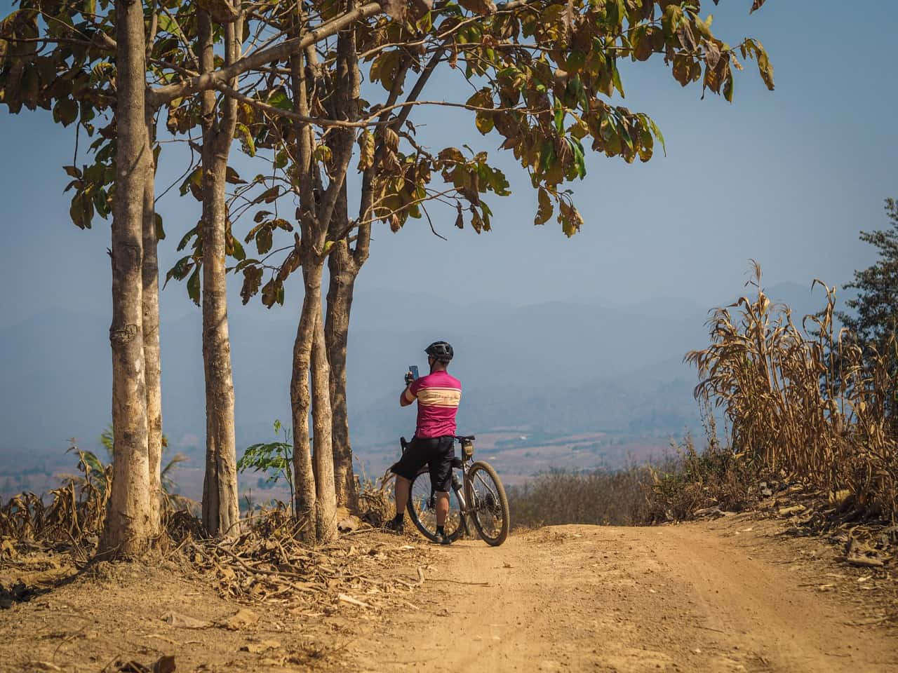 gravel cyclists photographing view in Thailand
